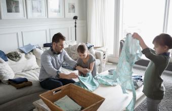 folding laundry in living room
