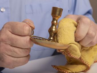 polishing brass candle sticks