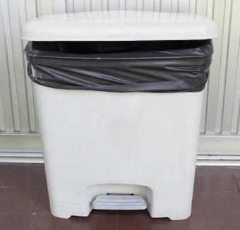 Plastic trash bin lined with bag for pet food storage