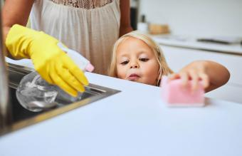 cleaning a kitchen surface together at home