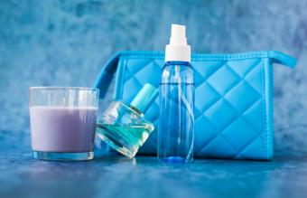 Beauty Products By Purse On Table
