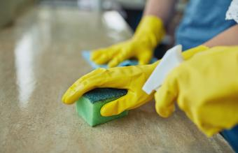 couple cleaning a surface at home