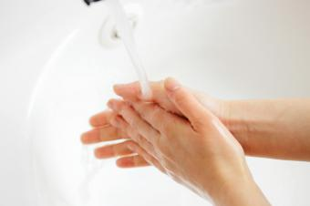 Person wetting hands with water