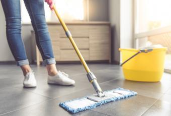 Woman dusting floor