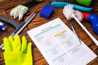 Cleaning Products Around Weekly Cleaning Plan Form With Pen