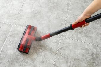 Woman cleaning floor steam cleaning