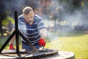 Man cleaning the barbecue grill