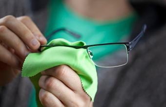 Man Cleaning Eyeglasses