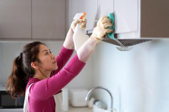 Wiping down the kitchen cupboards