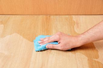Wiping wooden laminate parquet floor