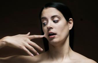 finger glued to her face