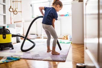 Girl vacuuming the carpet
