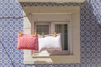 Throw pillows drying on a rope