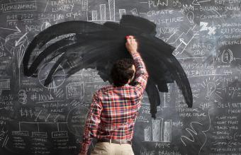 man cleaning chalkboard with coke