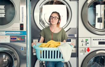 Young woman in a launderette