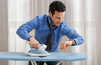 man ironing in a hurry