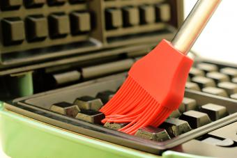 using a silicon brush to clean waffle iron
