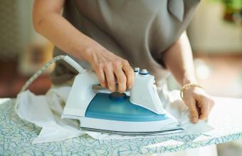 woman ironing on board
