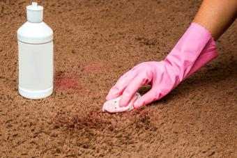 Removing nail polish stain with special chemical liquid