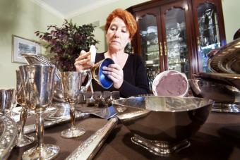Woman polishing silver