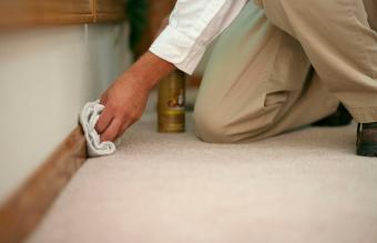 cleaning the baseboard of a home