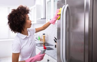 Woman Cleaning Refrigerator