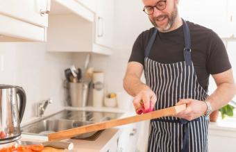 Man cleaning cutting board