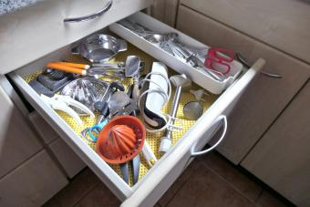 Kitchen utensils in an open drawer