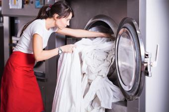woman washing white sheets