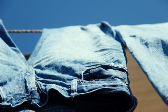 Drying pair of blue jeans on clothesline