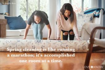 two women unrolling carpet