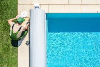 Man working on swimming pool
