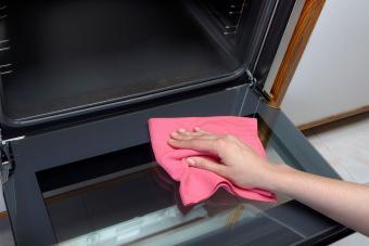 wipe oven door with cloth