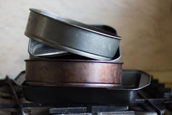 stack of tarnished cake pans