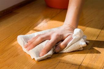 polish wood floor with cloth
