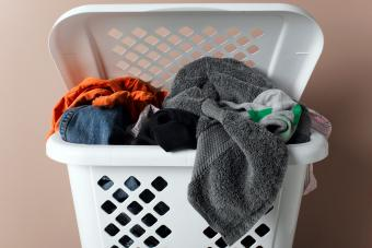 clothes basket hamper full of dirty laundry