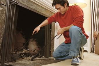 Man cleaning out fireplace
