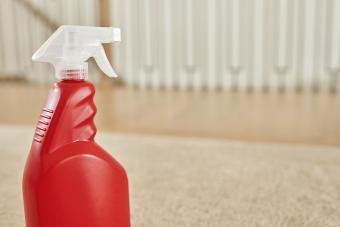 Spray bottle of hydrogen peroxide on beige carpet