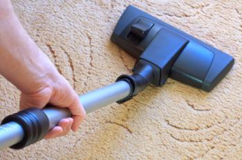 Vacuuming the carpet