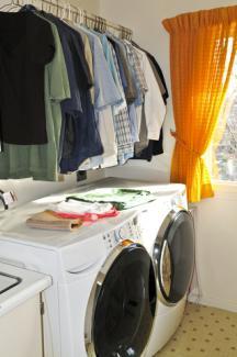 Clothing rod above washer and dryer; © Elena Elisseeva | Dreamstime.com