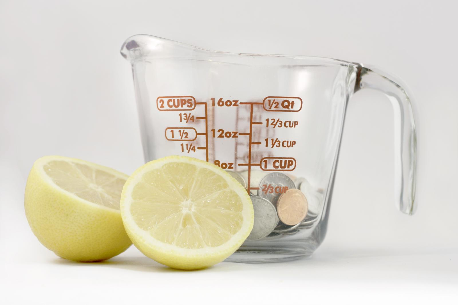 Lemon slices and measuring cup with pennies