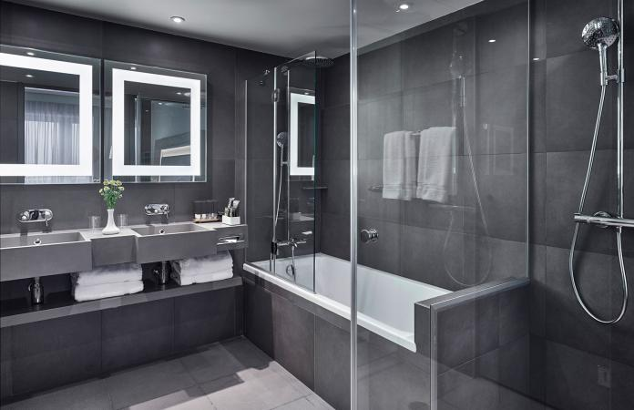 Modern bathroom showing sink and shower