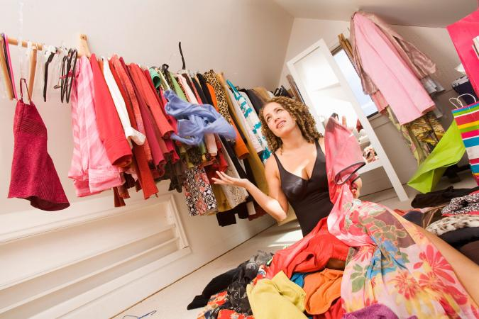 Woman in a messy closet