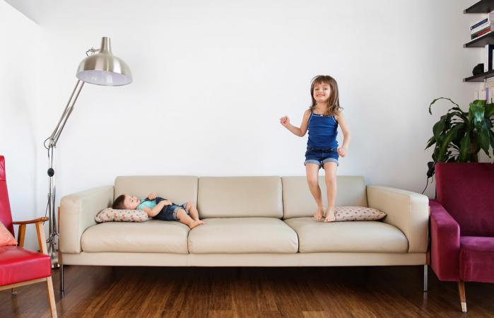 Girl jumping on sofa