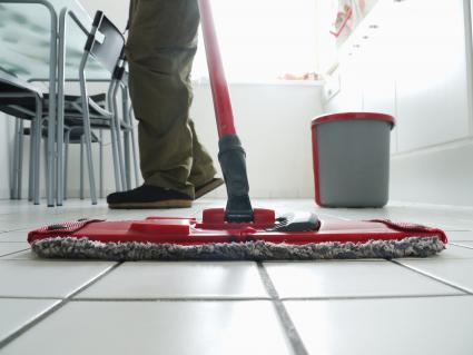 Cleaning Kitchen tiles with mop