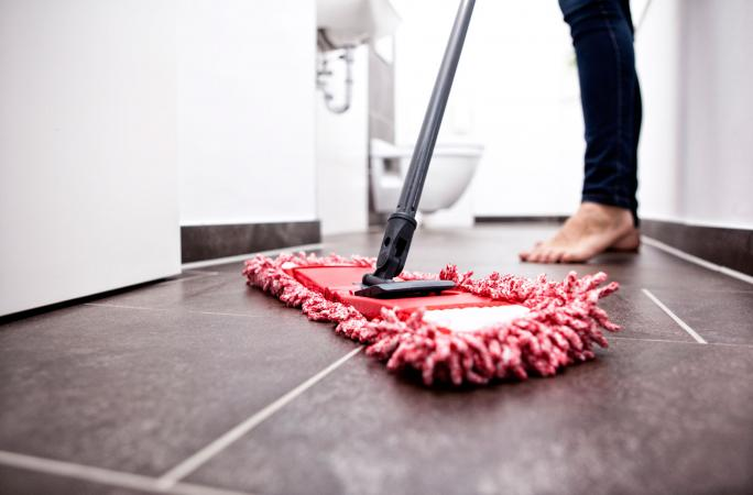 Cleaning bathroom tiles with mop