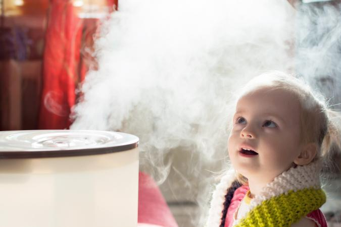 Baby girl with a humidifier