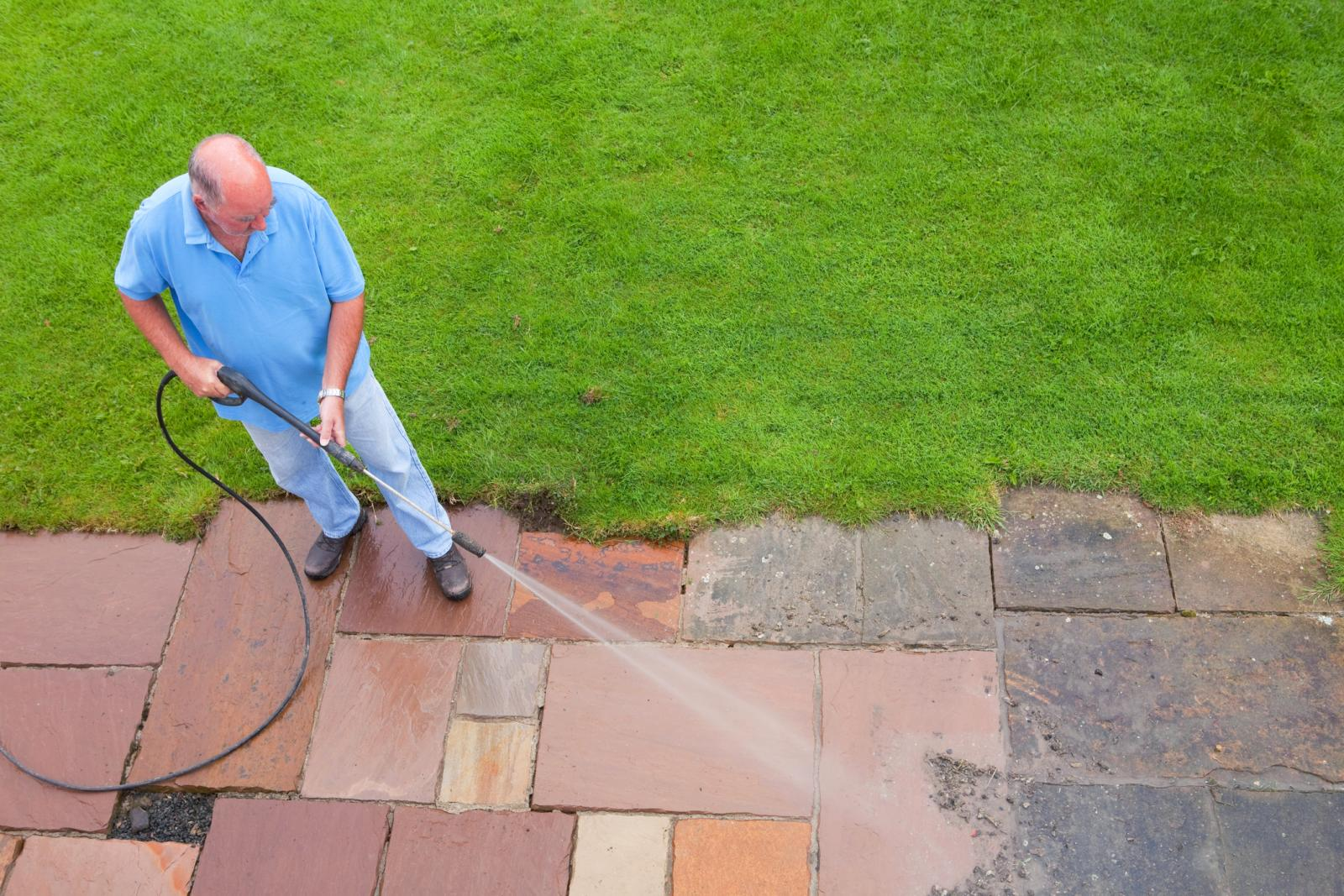 Man Washing Patio Slabs