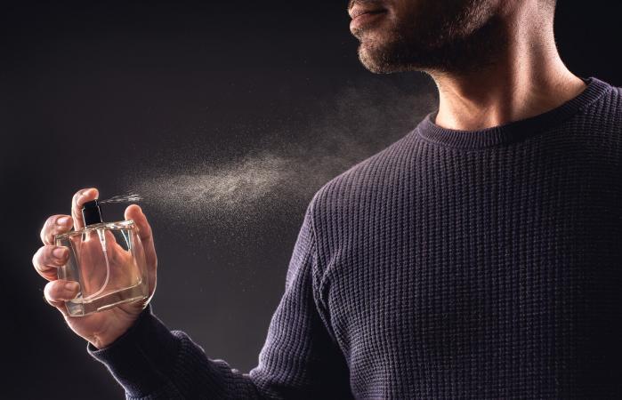 Man Spaying Perfume