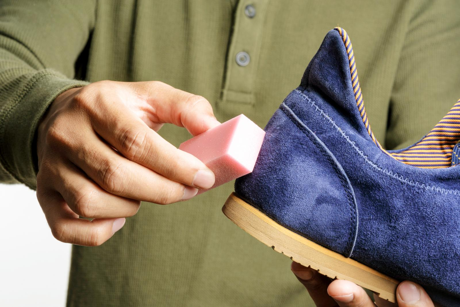 Man cleaning his suede shoe